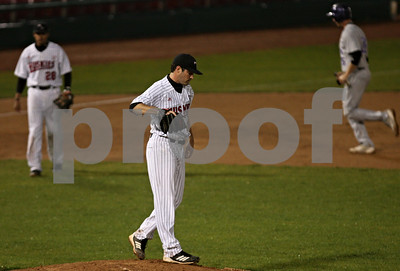 Rob Winner – rwinner@shawmedia.com  Northern Illinois pitcher Tom Barry walks behind the mound after walking in a run during the top of the first inning in Geneva Tuesday night.