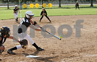 Rob Winner – rwinner@shawmedia.com  Kaneland hitter Haley Contorno drives in a run during the bottom of the second inning in Maple Park, Ill., Wednesday, May 2, 2012. Kaneland defeated DeKalb, 7-4.