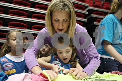 Rob Winner – rwinner@shawmedia.com  Elizabeth Taylor (top), of Montgomery, helps Nola Tellone, 5 of Aurora, while making a reusable bag from an old shirt as part of the Girl Scouts Forever Green service project during the Girls Scouts of Northern Illinois Centennial Celebration at the Convocation Center in DeKalb Saturday afternoon.  ***Yes, Elizabeth Taylor (cq)***