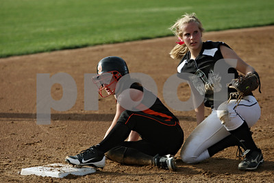 Rob Winner – rwinner@shawmedia.com  DeKalb baserunner Lindsey Costliow (left) slides safely into third base ahead of the tag of Kaneland third baseman Paige Kuefler during the top of the fourth inning in Maple Park, Ill., Wednesday, May 2, 2012. Kaneland defeated DeKalb, 7-4.