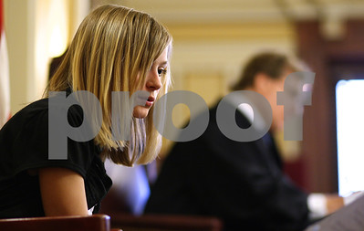 Kyle Bursaw – kbursaw@shawmedia.com  Abbie Krug, an eighth grader at Freeport portraying defendant Barbara Allen Barrett on the witness stand, leans in to read a piece of evidence during a mock trial held at the DeKalb County Courthouse on Monday, April 30, 2012.