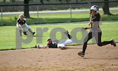 Rob Winner – rwinner@shawmedia.com  Kaneland shortstop Allyson O'Herron (center) is unable to get to a grounder on the left side as DeKalb courtesy runner Samantha Volk advances to third base during the top of the third inning in Maple Park, Ill., Wednesday, May 2, 2012. Kaneland defeated DeKalb, 7-4.