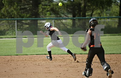 Rob Winner – rwinner@shawmedia.com  Kaneland baserunner Paige Kuefler (left) is caught in a run down as DeKalb catcher Alysha Guy throws to second base during the bottom of the first inning in Maple Park, Ill., Wednesday, May 2, 2012. Kaneland defeated DeKalb, 7-4.