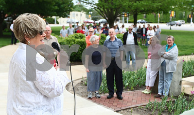 "Kyle Bursaw – kbursaw@shawmedia.com  Ruth Freund, a member of CrossWind Community Church in Genoa, leads the crowd in singing ""God Bless America"" at the National Day of Prayer ceremony on the DeKalb County Courthouse lawn in Sycamore, Ill. on Thursday, May 3, 2012."