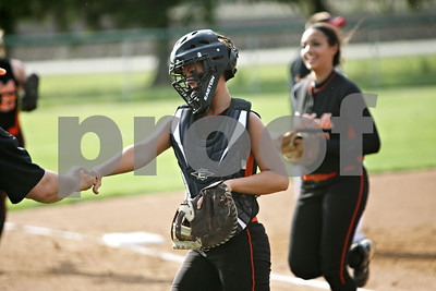 Rob Winner – rwinner@shawmedia.com  DeKalb catcher Alysha Guy is greeted by her coach Jeff Davis (left) after throwing out Kaneland baserunner Paige Kuefler (not pictured) to end the first inning in Maple Park, Ill., Wednesday, May 2, 2012. Kaneland defeated DeKalb, 7-4.