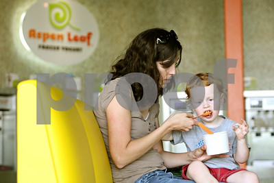 Rob Winner – rwinner@shawmedia.com  Sharon Ashley and her son Chase, 2, dig into a frozen treat together at Aspen Leaf Yogurt in DeKalb Friday afternoon. The self-serve frozen yogurt shop opened in February.  Friday, May 4, 2012 DeKalb, Ill.