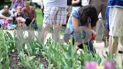 Kyle Bursaw – kbursaw@shawmedia.com  Genoa resident Pam Piazza kneels in prayer during the National Day of Prayer ceremony held on the lawn of the DeKalb County Courthouse in Sycamore, Ill. on Thursday, May 3, 2012.