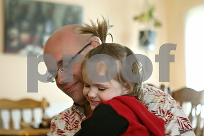 Rob Winner – rwinner@shawmedia.com  Patrick Cowles hugs his two-year-old daughter Abbiggail at their home in Sycamore Tuesday evening.  Abbiggail was diagnosed with autism in July 2011.  Sycamore, Ill. Tuesday, April 24, 2012
