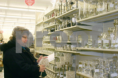 Patty Mulcahy of DeKalb shops at Hobby Lobby Monday on Sycamore Road in DeKalb. The store officially opened for business Monday; a grand opening will be held Jan. 3.  Caitlin Mullen - cmullen@daily-chronicle.com