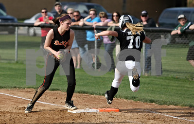 Rob Winner – rwinner@shawmedia.com  DeKalb second baseman Haley Tadd (left) steps on first base ahead of Kaneland baserunner Lexi Roach (70) to end the third inning in Maple Park, Ill., Wednesday, May 2, 2012. Kaneland defeated DeKalb, 7-4.