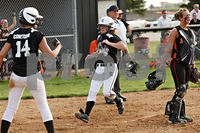 Rob Winner – rwinner@shawmedia.com  After scoring the tying run, Kaneland's Haley Contorno (14) cheers as teammate Sarah Grams scores the winning run during bottom of sixth inning in Maple Park, Ill., Wednesday, May 2, 2012. Kaneland defeated DeKalb, 7-4.