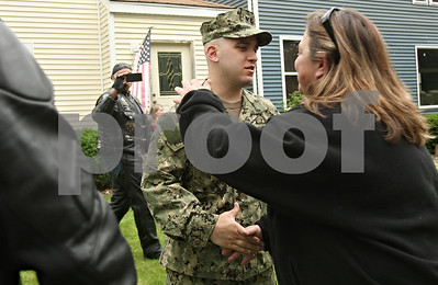 Rob Winner – rwinner@shawmedia.com  Navy GSE3(SW) Justin Cano is greeted by a group Warriors' Watch Riders in front of his family's DeKalb home on Saturday afternoon.