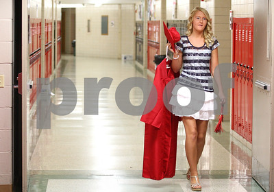 Kyle Bursaw – kbursaw@shawmedia.com  Kim Spickerman makes her way through the hallway at Indian Creek High School to get ready with the rest of the graduating seniors in the library before the ceremony on Sunday, May 13, 2012.