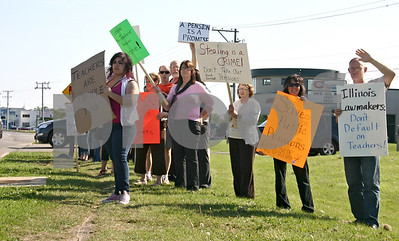Teachers from DeKalb and Sycamore school districts protest Wednesday in front of state Sen. Christine Johnson's Sycamore office. Many felt a pension bill was moving too quickly through the legislature and they wanted a more balanced approach to solving the state's pension crisis.  By Nicole Weskerna - nweskerna@shawmedia.com