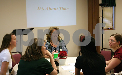 Jeff Engelhardt – jengelhardt@shawmedia.com  Rhonda O'Brien (center) talks with some of the women at the Moms Connected event on May 10 at the Evangelical Free Church of Sycamore-DeKalb. O'Brien was one of nine guest speakers the group brought in during the year.