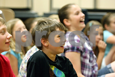 "Rob Winner – rwinner@shawmedia.com  Fourth grade student John Needham, 10, laughs during an educational program at Southeast Elementary School called ""The Kids on the Block,"" Tuesday afternoon."