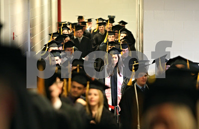 Rob Winner – rwinner@shawmedia.com  Northern Illinois University graduating seniors make their trek from Victor E. Court to the floor of the Convocation Center in DeKalb for the second of three undergraduate commencements on Saturday.