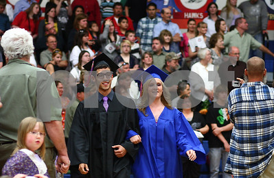 Kyle Bursaw – kbursaw@shawmedia.com  David Garza and Danielle Stensrud make their way to their seats during the Genoa-Kingston graduation ceremony on Wednesday, May 16, 2012.