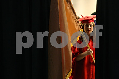 Rob Winner – rwinner@shawmedia.com  Northern Illinois University graduating senior Kate Booth peers out into the Convocation Center before the start of the second of three commencements in DeKalb Saturday afternoon.