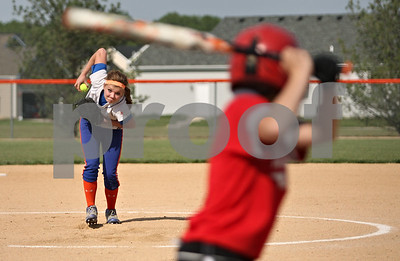 Rob Winner – rwinner@shawmedia.com  Genoa-Kingston pitcher Danielle Engle begins her wind up as Woodlands Academy batter Maggie Hambleton awaits the pitch in the first inning of a Class 2A GK Regional semifinal Tuesday afternoon. GK defeated Woodlands Academy, 11-0, in five innings.