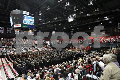 Rob Winner – rwinner@shawmedia.com  Northern Illinois University graduates and their families fill the Convocation Center in DeKalb Saturday afternoon.