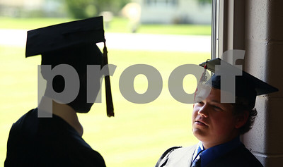 Kyle Bursaw – kbursaw@shawmedia.com  Seniors Shaquille Crayton (left) and Jared Landsteiner stay cool by an open door to their school library as the wait for the graduation ceremony to start on Sunday, May 13, 2012.