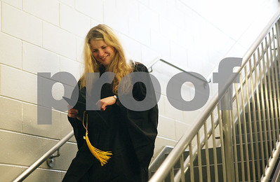 Rob Winner – rwinner@shawmedia.com  Luiza Aleksiejczyk, a business and marketing major, quickly makes her way down a set of stairs to Victor E. Court as the Northern Illinois University 2012 undergraduate class begins to line up to head inside the Convocation Center for commencement in DeKalb Saturday.