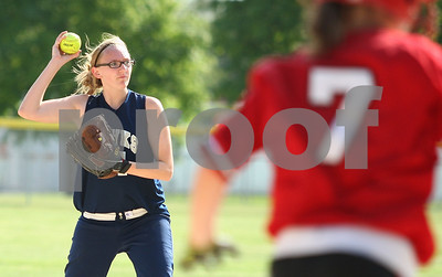 Kyle Bursaw – kbursaw@shawmedia.com  Mackenzie Adamson throws to first to try get out LaMoille batter Ragen Forbes during Hiawatha's 9-0 win over LaMoille in Kirkland, Ill. on Monday, May 14, 2012.