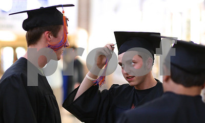 Kyle Bursaw – kbursaw@shawmedia.com  Zachary Zuberbier (face to camera) adjusts his tassel while chatting with his fellow graduating seniors before the Genoa-Kingston graduation ceremony on Wednesday, May 16, 2012.