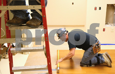Kyle Bursaw – kbursaw@shawmedia.com  Mark Flood, of Mr. David's Carpet, measures some linoleum to be cut for a room on the second floor of the expansion to Kishwaukee Community Hospital on Wednesday, May 9, 2012.