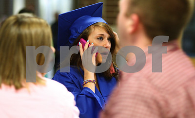 Kyle Bursaw – kbursaw@shawmedia.com  Stephanie Covington calls her mother to try and find her before the Genoa-Kingston graduation ceremony on Wednesday, May 16, 2012.