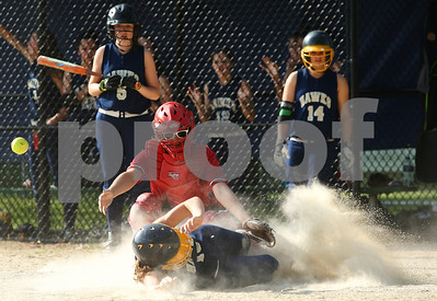 Kyle Bursaw – kbursaw@shawmedia.com  Haley Melendez slides safely into home plate for one of Hiawatha's nine runs as LaMoille catcher Erika Walzer can't hang onto the ball. Hiawatha defeated LaMoille 9-0 in Kirkland, Ill. on Monday, May 14, 2012.