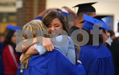 Kyle Bursaw – kbursaw@shawmedia.com  Genoa-Kingston junior Daphne Vassmer gives graduating senior Danielle Stensrud a hug that knocks her cap right off of her head before the ceremony on Wednesday, May 16, 2012.