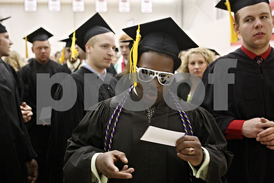 Rob Winner – rwinner@shawmedia.com  Finance major Rod Speech checks in within Victor E. Court before the start of the Northern Illinois University undergraduate commencement at the Convocation Center in DeKalb Saturday, May 12, 2012.