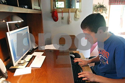 Rob Winner – rwinner@shawmedia.com  Ben Rydecki, winner of the 2012 DeKalb County Spelling Bee, practices spelling words on his computer at his family's Somonauk home on Friday evening.