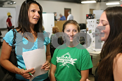 Rob Winner – rwinner@shawmedia.com  (From left to right) Sycamore resident Leslie Jacox and her daughter Brianna, 13, speak with Emily Barrile, a representative of the DeKalb County American Red Cross, during the Care or Be Square Youth & Family Volunteer Fair at the DeKalb County Community Outreach building Thursday evening. Brianna felt the need to get involved with volunteering and decided to attend the fair to get some information on how to help.  Thursday, May 24, 2012 DeKalb, Ill.