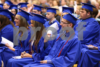 Kyle Bursaw – kbursaw@shawmedia.com  Hinckley-Big Rock senior Roman Hartman uses the program as a fan to cool off during the commencement ceremony on Sunday, May 20, 2012.