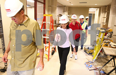 Kyle Bursaw – kbursaw@shawmedia.com  Larry Anderson (from left) Julia Fauci and Ruth Anne Tobias, all of the Ad Hoc Courthouse Committee, walk through the construction area on the first floor of the expansion to the DeKalb County Courthouse on Wednesday, May 23, 2012.