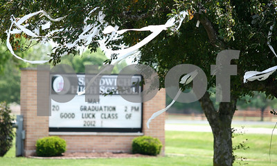 Kyle Bursaw – kbursaw@shawmedia.com  Severals trees at Sandwich High School have toilet paper hanging from the branches before the graduation ceremony there on Sunday, May 20, 2012.