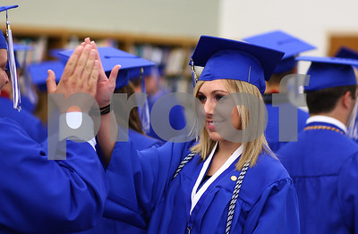 Kyle Bursaw – kbursaw@shawmedia.com  Rachel Phillips gives a high five to Jimmy Raymond as the graduating Hinckley-Big Rock seniors are asked to begin to line up for the ceremony on Sunday, May 20, 2012.