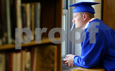 Kyle Bursaw – kbursaw@shawmedia.com  J.D. Oeters glances out the window in the library where the graduating Hinckley-Big Rock were getting ready for the ceremony on Sunday, May 20, 2012.