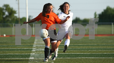 Kyle Bursaw – kbursaw@shawmedia.com  Sycamore's Katherine Kohler (right) takes a shot around DeKalb's Alli Smith during the Class 2A DeKalb Regional final on Friday, May 18, 2012. Sycamore beat DeKalb 2-0.