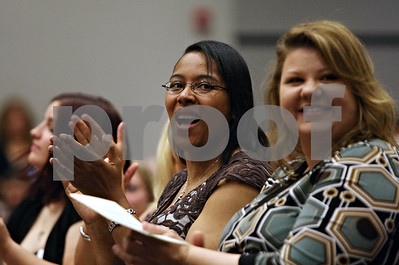 Rob Winner – rwinner@shawmedia.com  Students LaSaundra Chandler (left) and Lisa Carter applaud for their instructors before receiving their nursing pins during a pinning ceremony at Kishwaukee College in Malta Saturday morning.