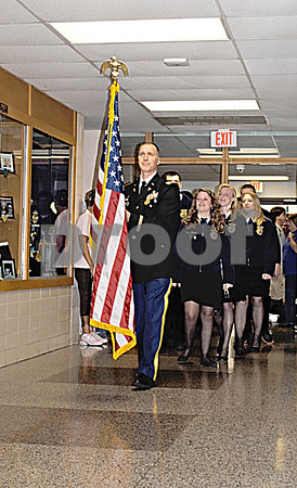 National Guard Capt. Rob Larkins leads those who attended the annual Memorial Day observance through the halls of Sycamore High School Friday.   By Nicole Weskerna - nweskerna@shawmedia.com