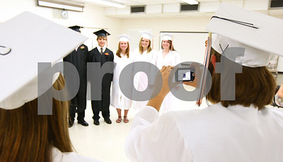 Kyle Bursaw – kbursaw@shawmedia.com  Hannah Prucha (right) takes a group picture of some of her fellow graduating seniors before the Sandwich High School graduation ceremony on Sunday, May 20, 2012.