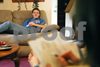 Rob Winner – rwinner@shawmedia.com  Ben Rydecki, winner of the 2012 DeKalb County Spelling Bee, practices spelling words read by his mother, Carole, at their Somonauk home on Friday evening.