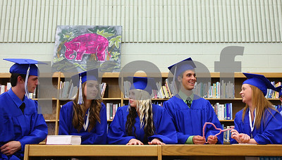 Kyle Bursaw – kbursaw@shawmedia.com  Calogero Catalanotto (from left), Alyssa Cowan, Alyssa Dahlman, Brandon Dillenback and Megan Hamm chat while lined up and waiting for the Hinckley-Big Rock graduation to begin on Sunday, May 20, 2012.