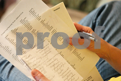 Rob Winner – rwinner@shawmedia.com  Carole Rydecki uses a list of words to test her son, Ben Rydecki, at their home in Somonauk on Friday evening.