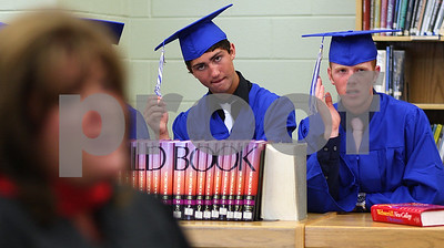 Kyle Bursaw – kbursaw@shawmedia.com  Hinckley-Big Rock graduating seniors Kris Beitel (center) and Cory Bradburn play with their tassels as Kim Halverson delivers some last words to the group as they wait in line before the ceremony on Sunday, May 20, 2012.