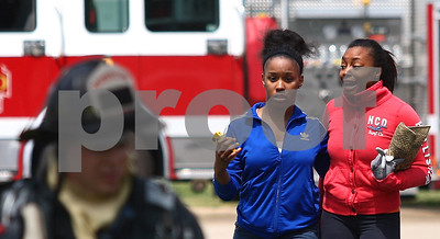 Kyle Bursaw – kbursaw@shawmedia.com  Roommates Brandi Gordon and Brandee Ross (right) react as Ross arrives on the scene of a fire that started in a neighboring apartment in their building at 1057 Ridge Road in DeKalb, Ill. on Monday, May 21, 2012.